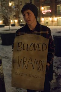 BYU freshman Carter Shelley attended the vigil with a self-made tombstone for Harambe. He and his roommates have a shrine to Harambe in their apartment. (Ryan Turner)