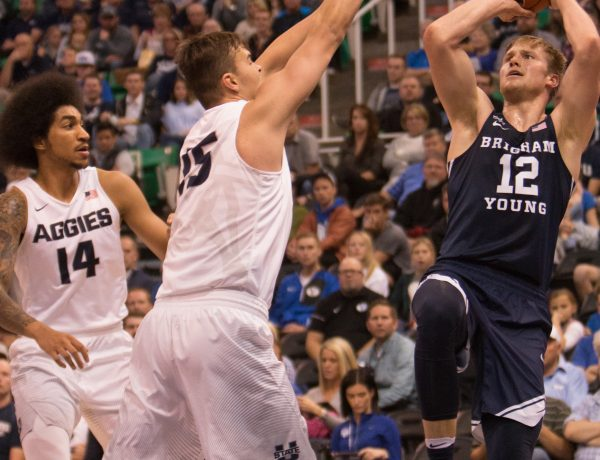 Eric Mika shoots over a Utah State defender. Mika