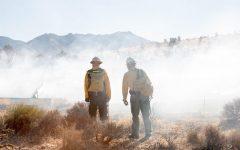 BYU professors observe the controlled burn in the Mojave desert. (Richard Gill)