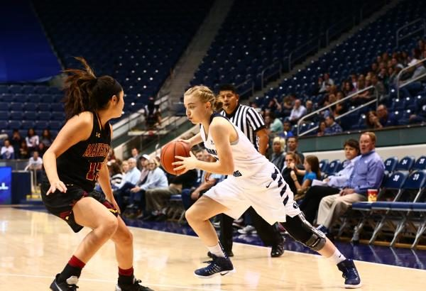 Liz Eaton drives by a defender earlier this season. Eaton is the younger sister of BYU women's basketball great Lexi Rydalch. (BYU Photo)
