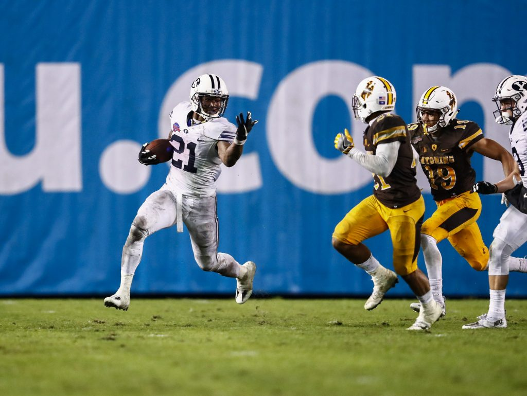 Jamaal Williams outruns and taunts a Wyoming defender in the Poinsettia Bowl. Williams ran for 210 yards in the game. (BYU Photo)