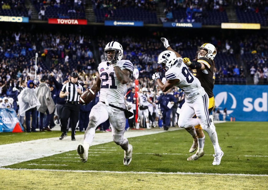 Jamaal Williams celebrates after scoring a touchdown in the Poinsettia Bowl. (BYU Photo)