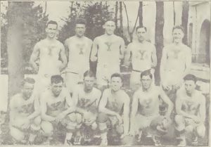 """""""'Y' team that battled the U. of U.'"""" Jan. 22, 1921. Reading from left to right: front row. Bentley F., McIntosh G., Snow C., Richards G., """"Bunk"""" Brown F., Gardner F., back row, Weight G., Reeves G., Dunn C., H. Brown f., Swenson F."""