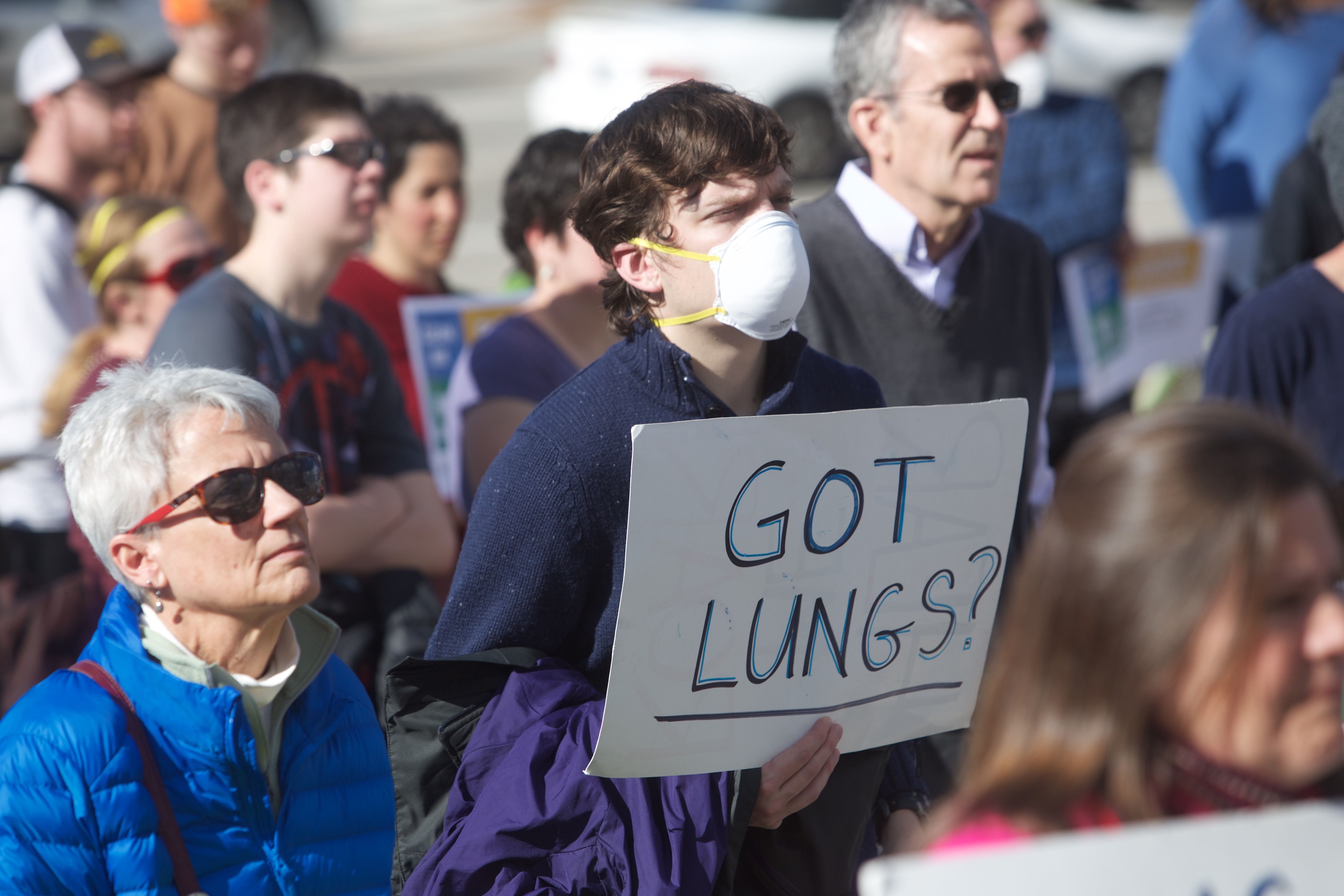 Rally attendees hold signs and wear face masks to voice their concern about Utah's poor air quality.(Gianluca Cuestas)