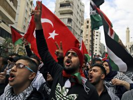 AP Photo/Bilal Hussein