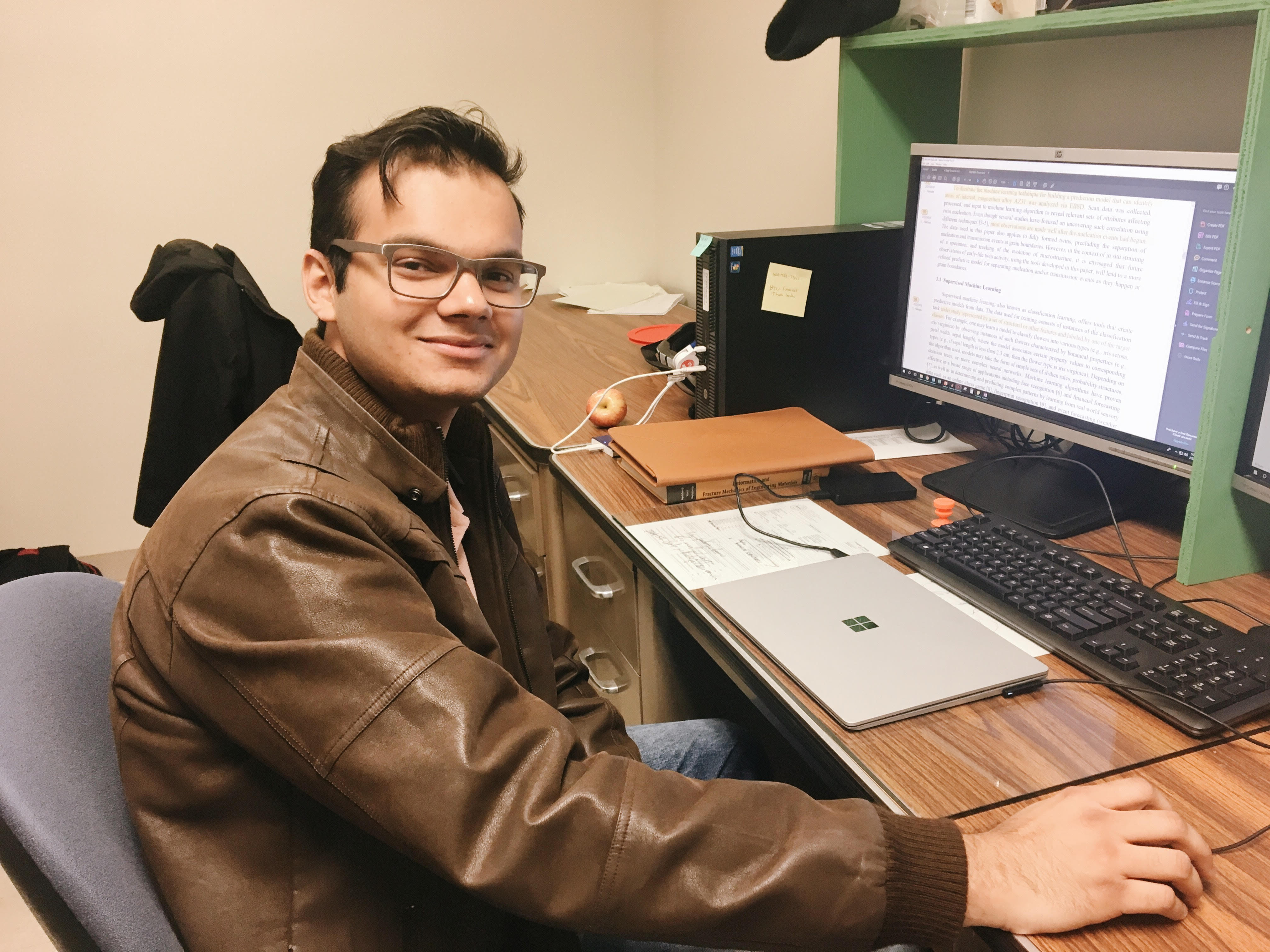 Byu Graduate Student Rishabh Sharma Sits At His Desk In An Engineering Lab The Basement Of Clyde Building Katelyn Stiles