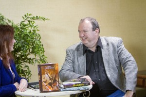 Author Tracy Hickman speaks on camera about his books at the annual Life, the Universe, and Everything conference about fantasy literature. Photo by Sarah Hill.