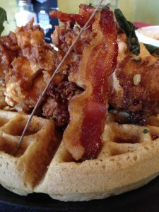 The bacon covered sage-fried chicken and waffles is one of Station 22's signature dishes. (Photo by Ee Chien Chua)