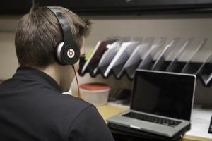 Scott Hunter listens to music with his Dr. Dre Headphones. Elliott Miller