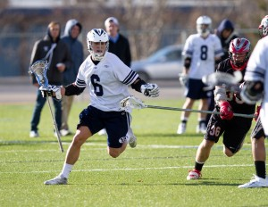 Sophomore attackmen Mike Fabrizio wards off a New Mexico defensemen. BYU plays three away games in seven days. (Photo by Sarah Hill)