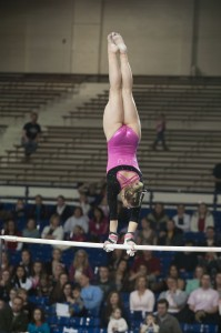 Eliane Kulczyk competes on bars at BYU gymnastics meet.