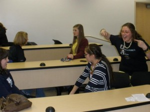 Palethorpe (far right) works with students at ASL club. (Photo courtesy BYU ASL Club Facebook page)