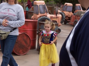 Eleanor Anderson is having fun in the Disneyland with her parents.