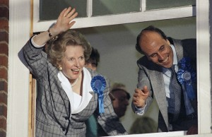 In this June 12, 1987 file photo, British Prime Minister Margaret Thatcher waves to supporters from Conservative Party headquarters in London after claiming victory in Britain's general election