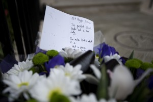 A floral tribute is seen after being laid outside the home of the late former British Prime Minister Margaret Thatcher in London, Monday, April 8, 2013.