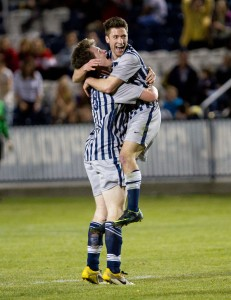 Jonathan Junca and Tanner Whitworth  celebrate in a game against University of Utah. (Photo by Sarah Hill)