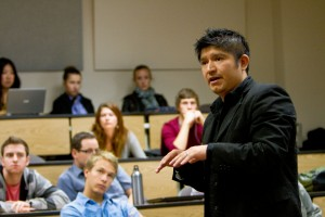 Lamoni Limon, a member of the Microfinance Club, tells students about his microfinance organization. (photo by Sarah Hill)