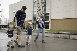 Jonah Barnes, a BYU student, spends time with his family on campus. (photo by Elliott Miller)
