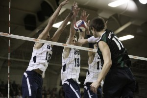 Ben Patch, Taylor Sander and Devin Young block a kill in the opening round game of the conference tournament against Hawaii. (Photo by Elliott Miller)