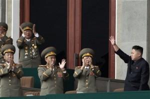 North Korean leader Kim Jong Un, left, waves as North Korean military officers clap at a stadium in Pyongyang. (AP Photo)