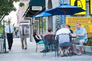 A group of people eat at Rocco's Tacos on Center Street in Provo on a summer evening. Photo by Chris Bunker