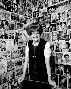 "Janie Thompson in her office surrounded by photos of her ""kids."" (Courtesy BYU Photo)"