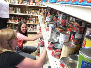 Volunteers stock shelves at the Community Action Food Bank in Provo. (Photo courtesy Community Action)