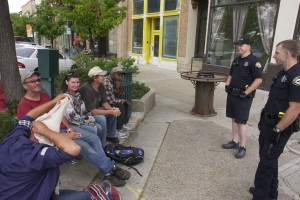 Panhandlers talk to Provo Police along Center Street. (Photo by Andrew Williamson)