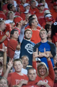 A couple BYU students find themselves in the middle of some Utah fans during last season's game. Photo by Chris Bunker.