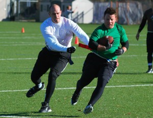 A quarterback eludes a defender during intramural competition Saturday. Air Raid game-plans several designed plays, including quarterback draws. Photo by Maddi Dayton