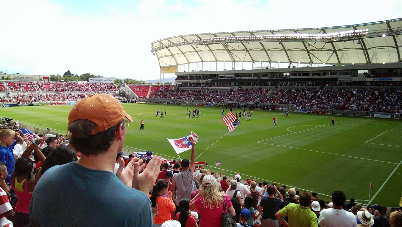 Fans showing their national pride as the cheer on the U.S. Men's National Soccer team in Rio Tinto Statium. Photo by Colin Holmes.