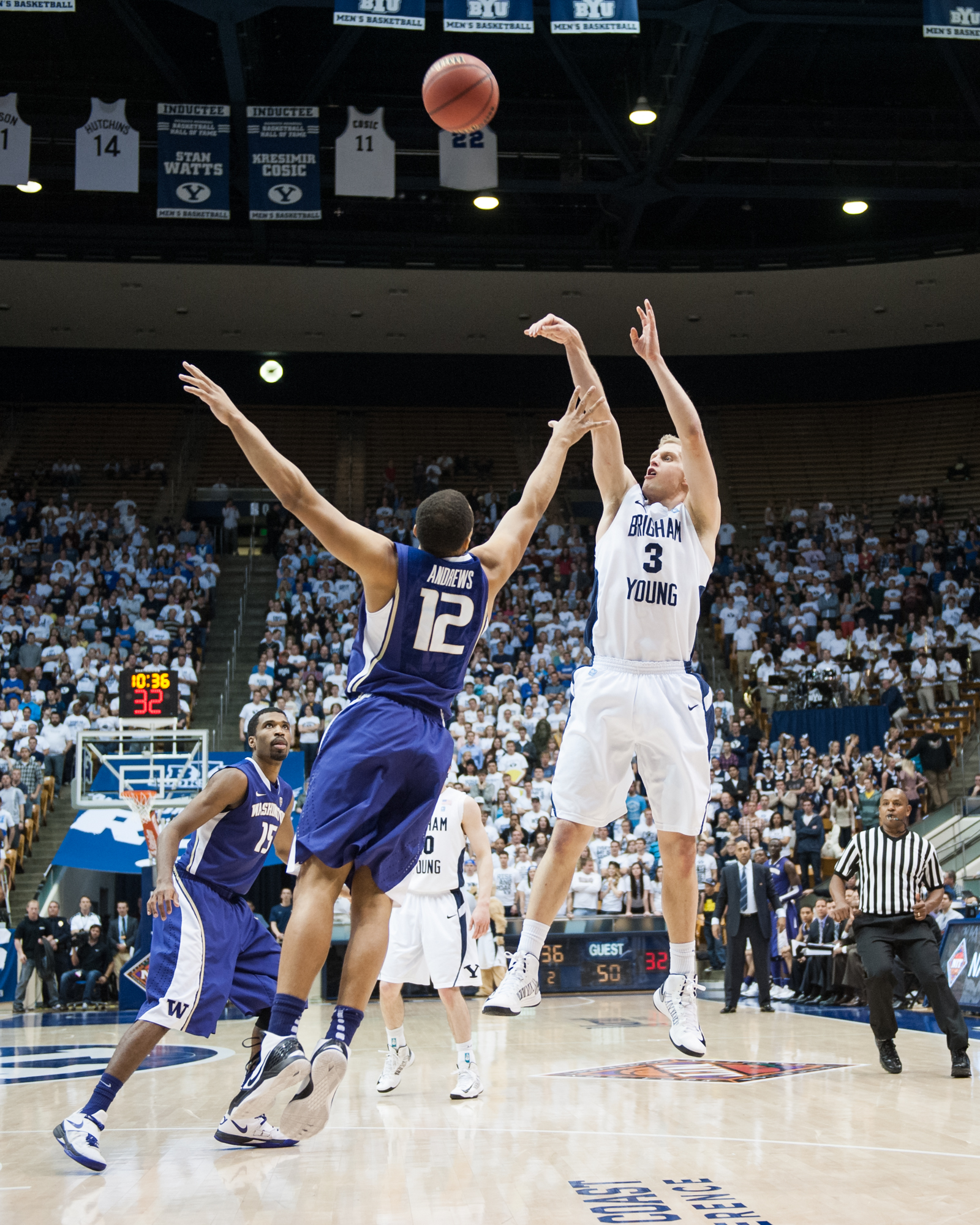 BYU guard Tyler Haws shoots over Washington defender Andrew Andrews during the 2012 NIT tournament. (Photo by Sarah Hill)