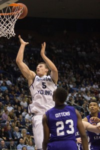 Sophomore guard Kyle Collinsworth goes up for a layup against Weber State. Photo by Ari Davis