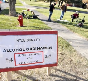 In a Nov. 6, 2012 photo, people try to get signatures onto a petition to have a vote on the issue of alcohol sales, in Hyde Park, Utah. Residents can vote to lift a long-standing ban on the sale of alcohol in Tuesday's election. Hyde Park, population 4,000, is among a handful of dry cities left in a state known for its tee totaling ways. (AP Photo/The Herald Journal, Eli Lucero)