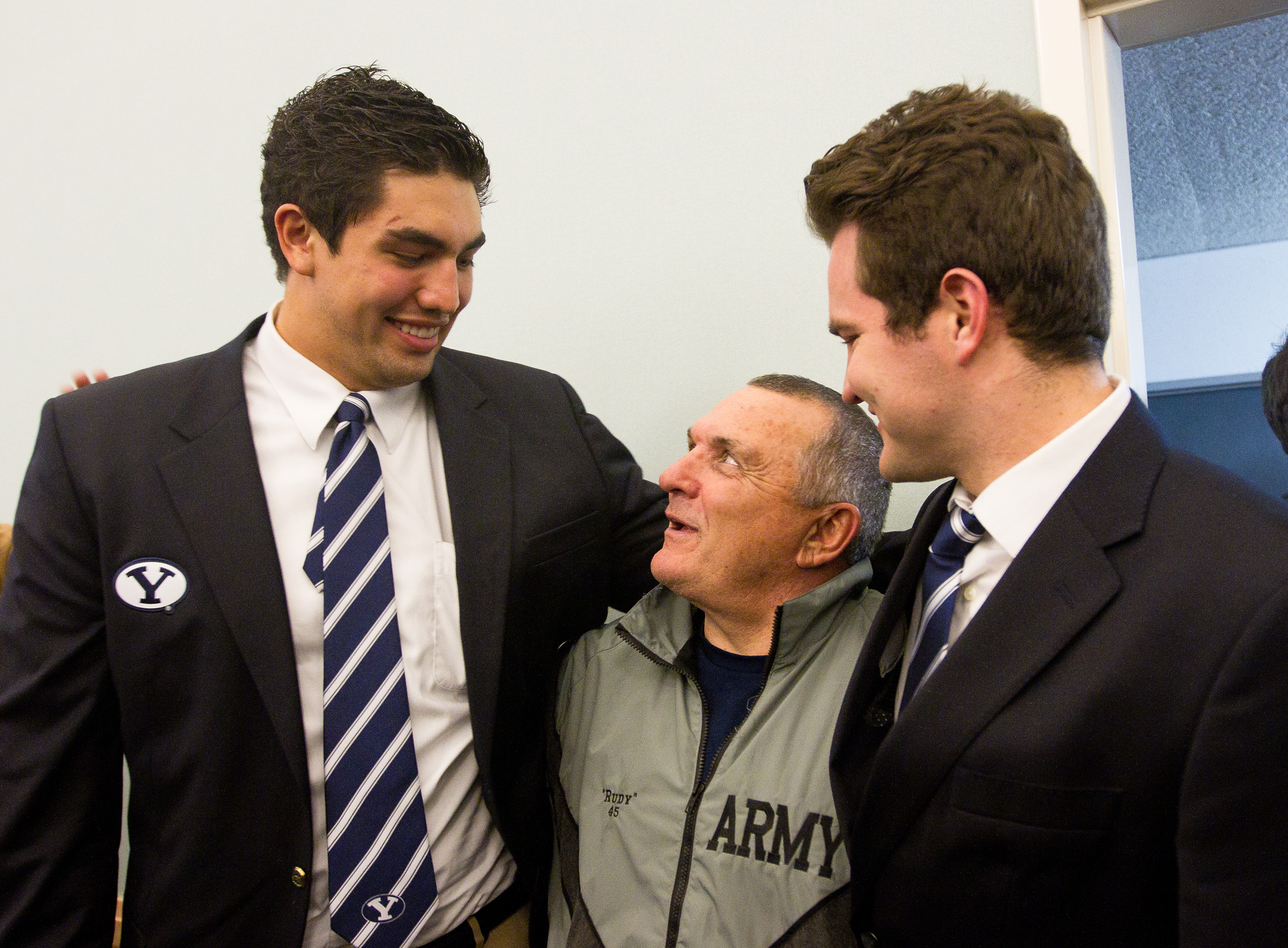 BYU football players Bronson Kaufusi and Skye Povey talk with Notre Dame legend Rudy Ruettiger at the team's traditional pregame fireside Friday, Nov. 22, 2013. (Photo by Sarah Hill)