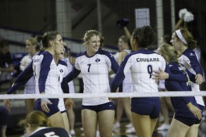 The women's volleyball team celebrates a point against Portland. Photo by Sarah Hill