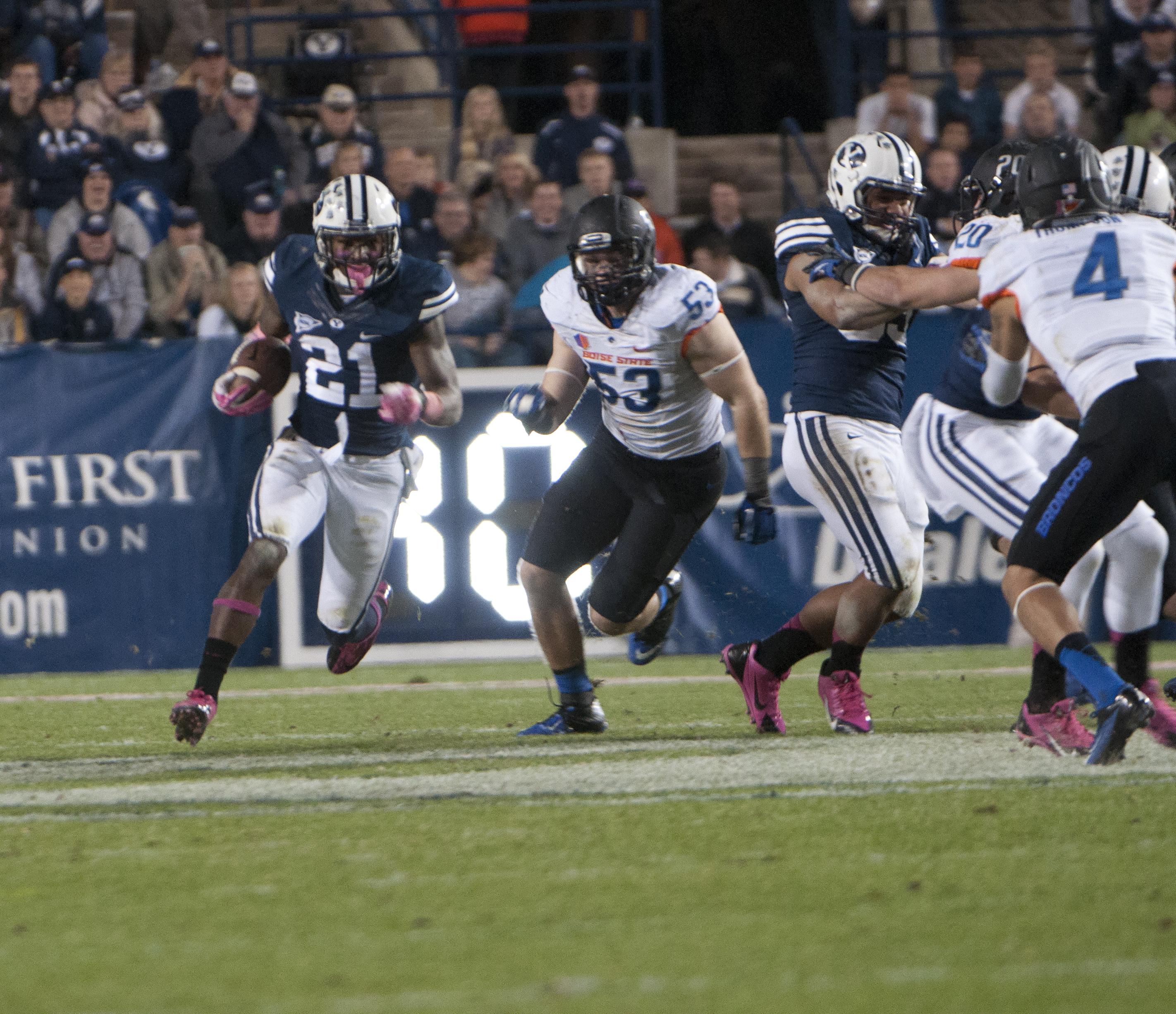Jamaal Williams outruns his Bronco defender in the Boise State vs. BYU game. (Photo by Maddi Dayton)