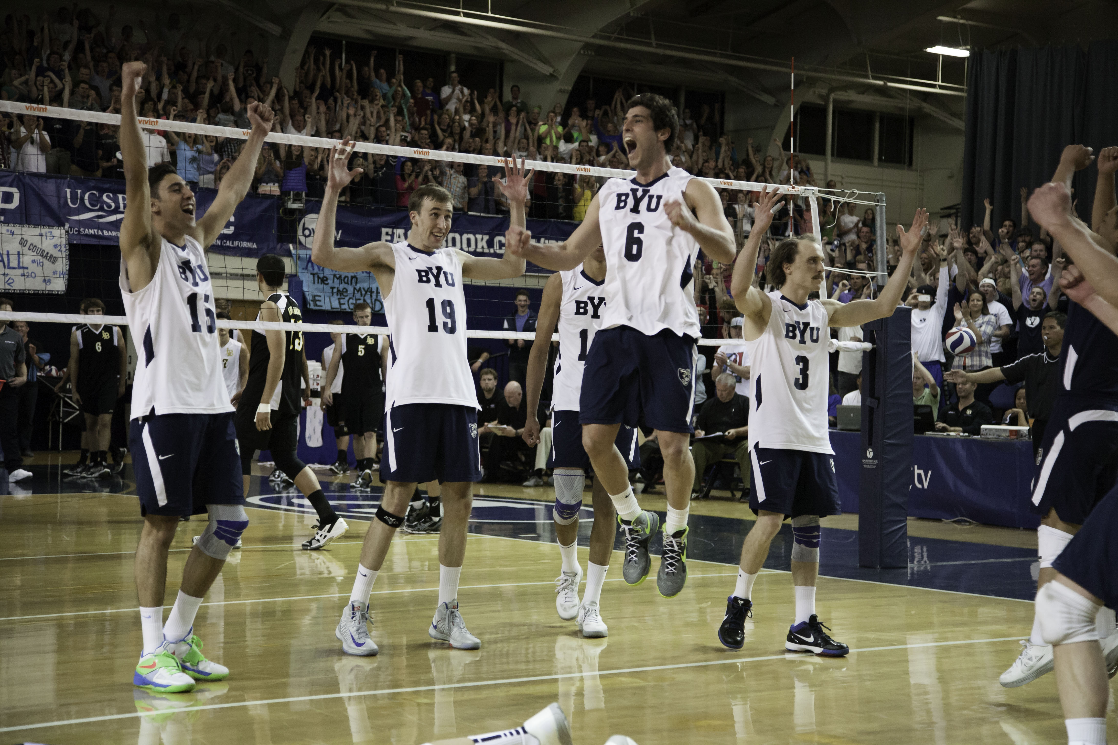 The BYU volleyball team celebrates after winning the final point to clinch the 2013 MPSF Championship title. The team progressed all the way through the NCAA Tournament, making it to the NCAA Championship game, where it fell to UC-Irvine. (Photo by Elliott Miller)