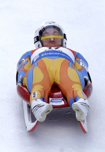 BYU student Kate Hansen races down the track during the Luge World Cup Friday, Dec. 13, 2013, in Park City, Utah. Hansen finished 4th and will represent the USA at the upcoming Olympics in Sochi, Russia. AP Photo by Rick Bowmer