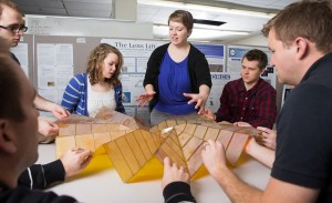 Graduate student Shannon Zirbel works with BYU engineering students to design compact solar panels using origami techniques.