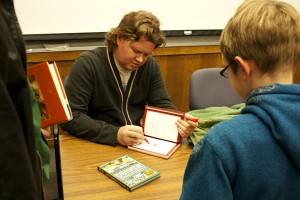Nathan Hale signed his books after the presentation.