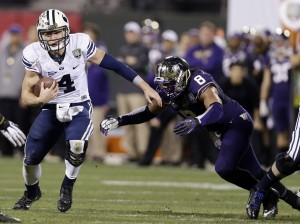 Taysom Hil runs past a Washington defender during the first half of the Fight Hunger Bowl on Dec. 27 in San Francisco. Photo Courtesy AP Photo/Marcio Jose Sanchez.