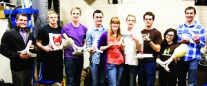 Members of the Prosthetics Club show prosthetic legs at various stages of completion. (Photo by Elliott Miller)