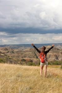 A hiker overlooks the North Dakota Badlands. Photo courtesy North Dakota Tourism.