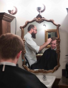 Drew Danburry juggles interview questions and cutting BYU Statistics student Andrew Brock's hair simultaneously.