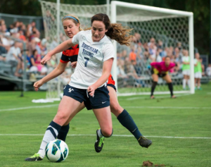 Attacking Midfielder Michele Murphy takes on Cal State Fullerton player during a pre-season game just before tearing her ACL. (Photo courtesy of Michele Murphy.)
