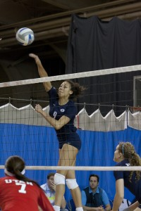 Alexa Gray spikes the ball over the net during the University of Utah game last season. (Natalie Stoker)