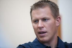 Defensive Coordinator Nick Howell speaks with reporters during Football Media Day. (Elliott Miller)