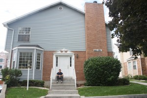 Andrew Lindsey, a public health major from Orem, sees both the pros and cons of living at his parents' home in Provo versus living near campus at Chattham Townhomes.
