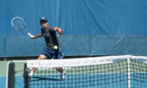 Sophomore Juan Canales prepares to hit a forehand during this weekend's play.
